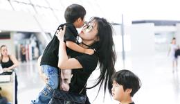 冉莹携带儿子现身机场 邹市明的老婆冉莹颖儿子照片